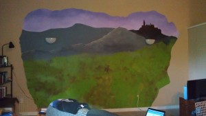 The end of Day One of painting. The mountains are up, Hogwarts is up, and there are two disembodied light fixtures.